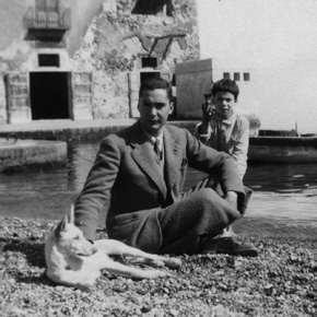 Malaparte with his dog febo and a child of a fisherman, taken on the
