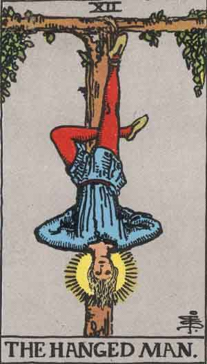 The Hanged Man (XII) from the Rider-Waite tarot deck illustrated by Pamela Colman Smith, 1909. Wikimedia Commons