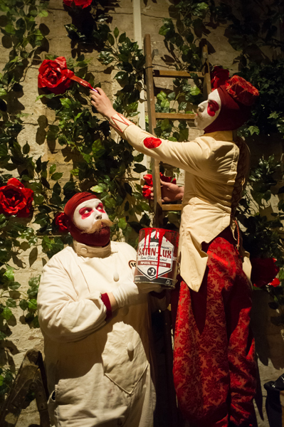 A border guard (Brendan McCoy) and the Knave (Tom Moores) paint the roses in the Queen's Garden © Jane Hobson