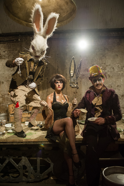 The White Rabbit (Mark Stevenson), the March Hare (Grace Carter) and the Mad Hatter (Hayden Wood) at the Tea Party © Jane Hobson