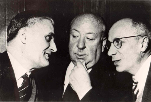 Pierre Boileau (<i>right</i>) and Thomas Narcejac pose with Alfred Hitchcock. From the private collection of Patrice Rome