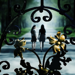 Behind the black gates