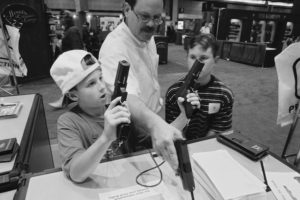 "<em>""Tanner first fired a gun aged three. He now owns a .243 Ruger rifle, a Remington 58 and a 20-guage automatic shotgun. Andrew has a Browning Rifle, a Remington pump-action shotgun and a military rifle. I've got about 50 guns.""</em>"