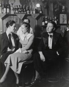 """<em>At Le Monocle</em> by Brassaï, 1933. <a href=""""https://www.moma.org/collection/works/58849"""" target=""""_blank"""" rel=""""noopener"""">MoMA</a>"""