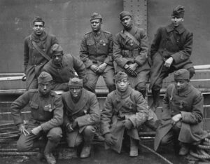 """The Harlem Hellfighters, 1918 (photographer unknown). <a href=""""https://en.wikipedia.org/wiki/369th_Infantry_Regiment_(United_States)#/media/File:369th_15th_New_York.jpg"""" target=""""_blank"""" rel=""""noopener"""">US National Archives</a>"""