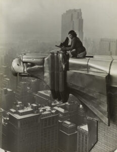 """Margaret Bourke-White atop the Chrysler Building by Oscar Graubner, <em>c</em>. 1930. <a href=""""https://www.moma.org/interactives/objectphoto/artists/712.html"""" target=""""_blank"""" rel=""""noopener"""">MoMA/Library of Congress</a>"""