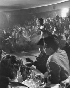 """Billie Holiday singing at Cafe Society by Gjon Mili, 1947. <a href=""""https://nypost.com/2016/07/15/nycs-first-integrated-nightclub-was-a-30s-celeb-magnet/"""" target=""""_blank"""" rel=""""noopener"""">LIFE Picture Collection</a>"""